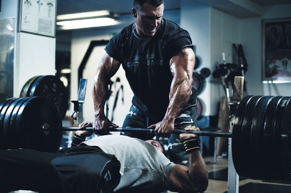 a man liftingwith his coachs help