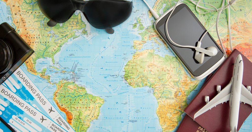 a map of world and some travel equipment