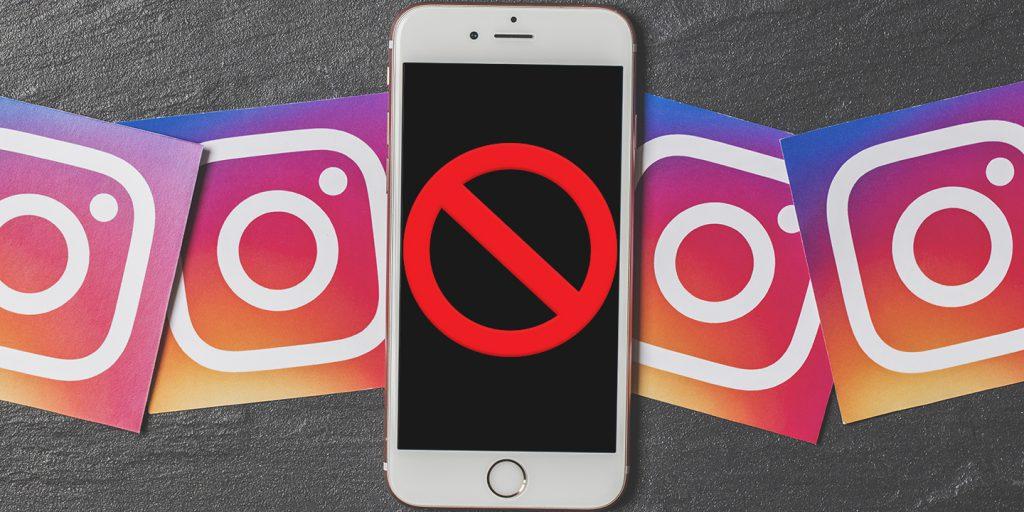 a cellphone between instagram logos