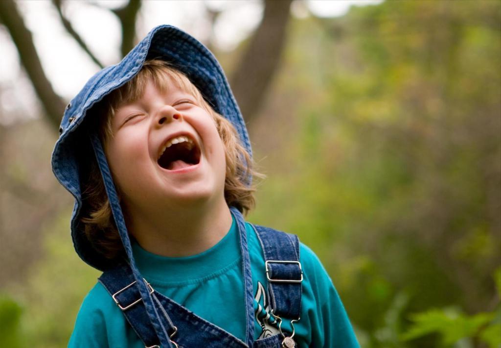 a kid is laughing loud